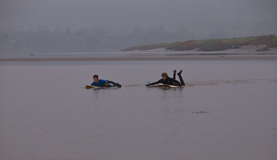 Surfers paddling out for the bore arrival. Bendy - what is that you are on?