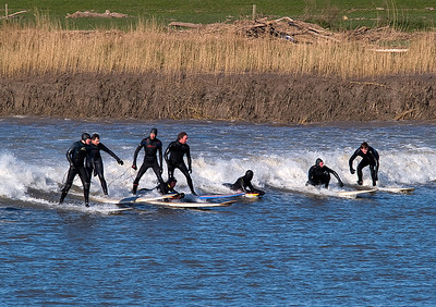Nice shot of all the guys riding the wave.