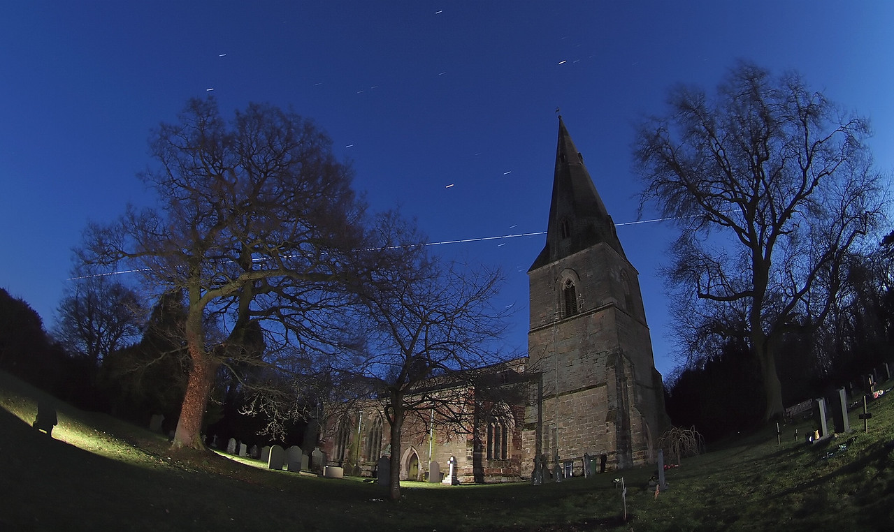18 Feb 2012. A very bright pass of the International Space Station (ISS) at 1806hrs. A difficult long exposure because of the ambient light having just lost the sun only half hour or so before. The ISS flew across the Orion constellation, so this was my composition guide (just left of spire), having chose my church location. Set camera on tripod and fine tuned the exposure time to 4s at F4, ISO 320. Captured with Olympus E5 & 8mm fisheye. Shot approx 80 exposures continuous and ran around the churchyard firing off isolated strobes. Stacked the frames using StarStax software. It was such a bright pass, made good by very clear skies after passage of a cold front earlier, combined with a polar airmass keeping the air cool and clear :-)