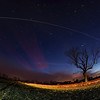 Christmas Day ISS 25 Dec 2013. The International Space Station (ISS) flies over East Midlands (1711hrs flyby).  A very bright flyby over rural field in East Mids.<br /> <br /> How did I capture this? - Camera (Olympus E-M1) with fisheye lens (Oly 8mm) set on tripod. I located the camera in a field and composed around the tree, knowing the ISS would pass over from west to east. Setting camera in manual mode, f3.5, ISO 320 & 10s exposure time & using remote cable to shoot continuous for approx a dozen or so shots. The field was painted with a few flash bursts, although a passing car completed the job for me :-)  Once complete I imported all images & stacked in software to produce this composite image.