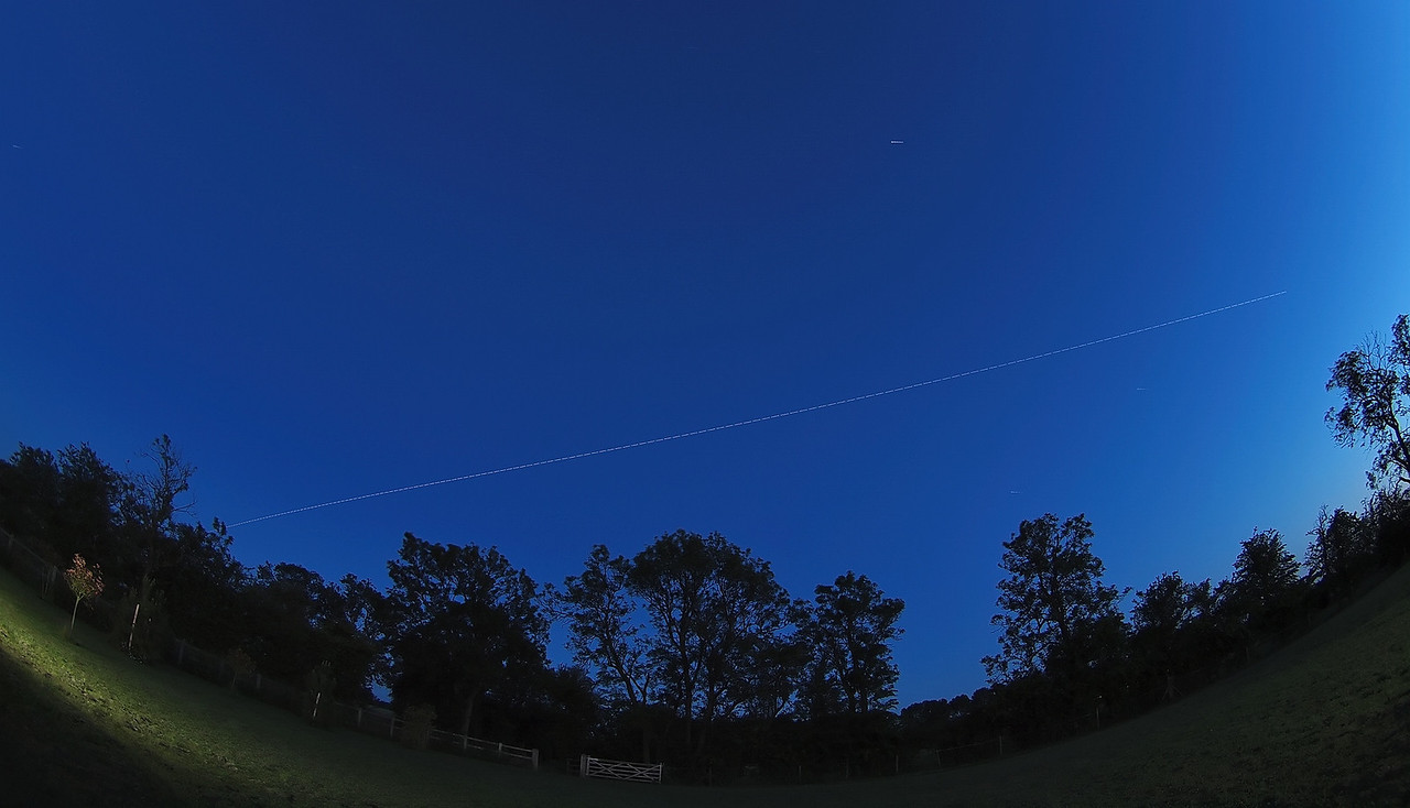 June 26 2011. ISS is making its last few passes before it's orbital path departs UK skies. Very difficult capture tonight (2221hrs) due to ambient light. Had to reduce exposure time down to 1s & reduce ISO to 200. Captured Oly E5 & 8mm fisheye.