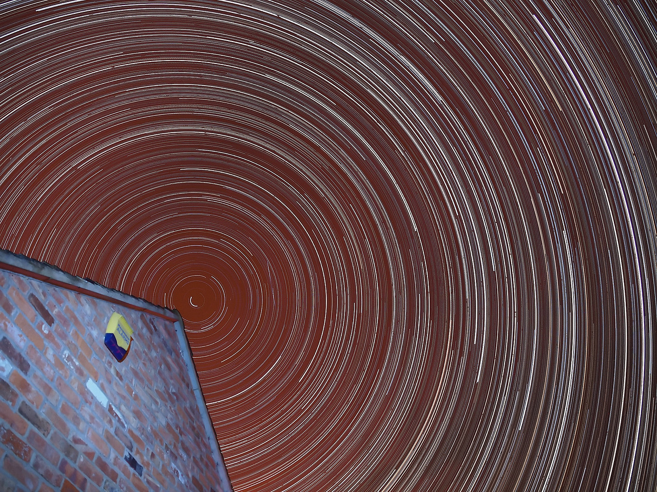 18/19th Feb 2012. Mesmerising startrail from a very clear night in sth Leics. Targeting the celestial north pole star (polaris) via an apex from a building and using a 12mm focal length (12-6mm SWD) resulted in this wonderful spinner. Over 9hrs of earths rotation shown visibly through the stars spinning. Captured with Olympus E5 15s exposures shot continuous all night and kept from freezing over with dew/heat shield. Over 2000 images imported to StarStax which produced this final composite. Mesmerising :-)