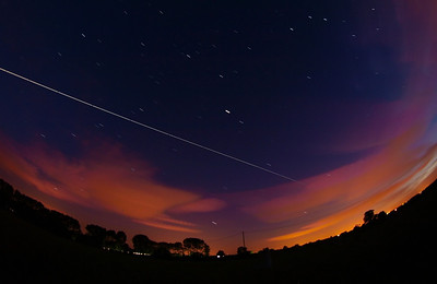 July 03 2010. 2321hrs flyby over Leics, UK. Progress 38 supply ship docked to ISS earlier today. Captured with Olympus E3, 8mm fisheye f3.5, 15s exposures. Approx 12 in number stacked in startrails.de. Passing clouds made for some nice colour.