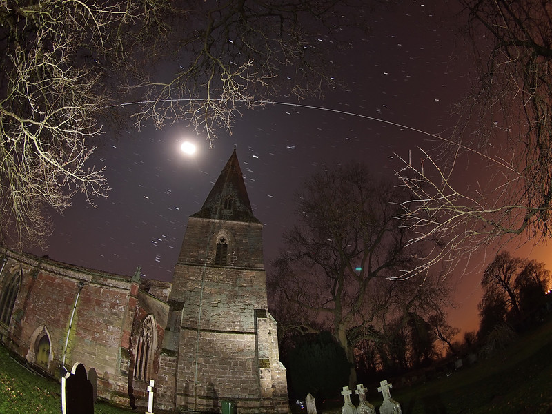 19 Feb 2013. 1855hrs ISS flyby over Misterton church, Leics, UK. The West to East flyby was directly overhead and again quite challenging to capture. Another one of my local sites was chosen and I composed around the church and anticipated flyby over the moon.  Composition only made possible due to fantastic wide angle capability of the Olympus 8mm fisheye. 13 No 15s exposures, F3.5, ISO 640 and put together with Starstax software.