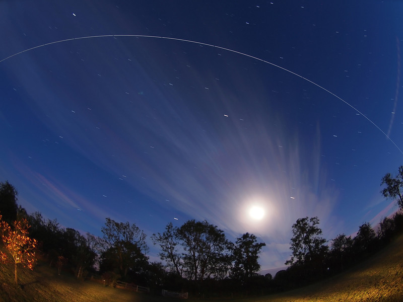 ISS flyby 2301 hrs, 08 June 2014. Composite image of the ISS pass flying over the bright moon. Captured using Olympus E5 & 8mm fisheye lens. Approx 15 no 15s exposures shot brought together with software to create the composite flight path :-)
