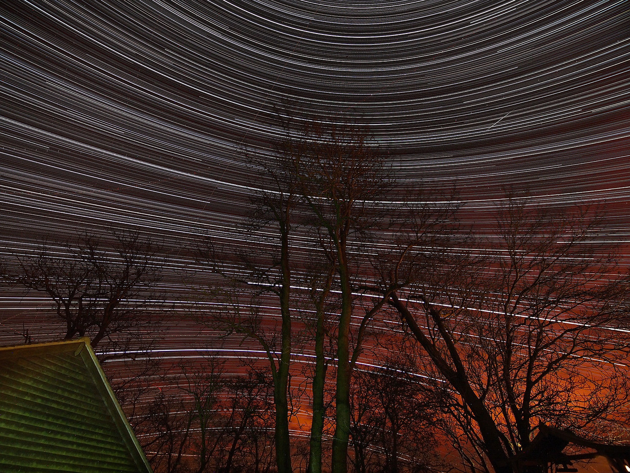 Star Trail captured on evening/morning Dec 8/9th. Looking due south and a very nice example detailing the opposing curvature of the trails above and below the celestial equator. Caught a meteor too (top right). Captured with Olympus E5 & 7-14mm. Temps dropped to -4C overnight and skies were exceptionally clear. Home made dew shield kept the ice/moisture at bay. Camera was put outside at approx 7pm and left out all night for 12 hrs of continuous shooting. 15s exposure @ F4 via remote cable locked for cont shooting. 3000 images imported and stacked to produce final exposure.