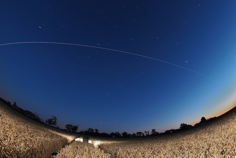 August 20th 2012. 2117 hrs flyby. Stunning super bright ISS pass. Captured flying out of the setting sun and across the twilight skies. Trickier exposure due to ambient light so reduced exposure down to 5s and ISO 400. Captured with Oly E5, 8mm fish. Numerous 15s exposures, F3.5 and composite stacked with StarStax software.