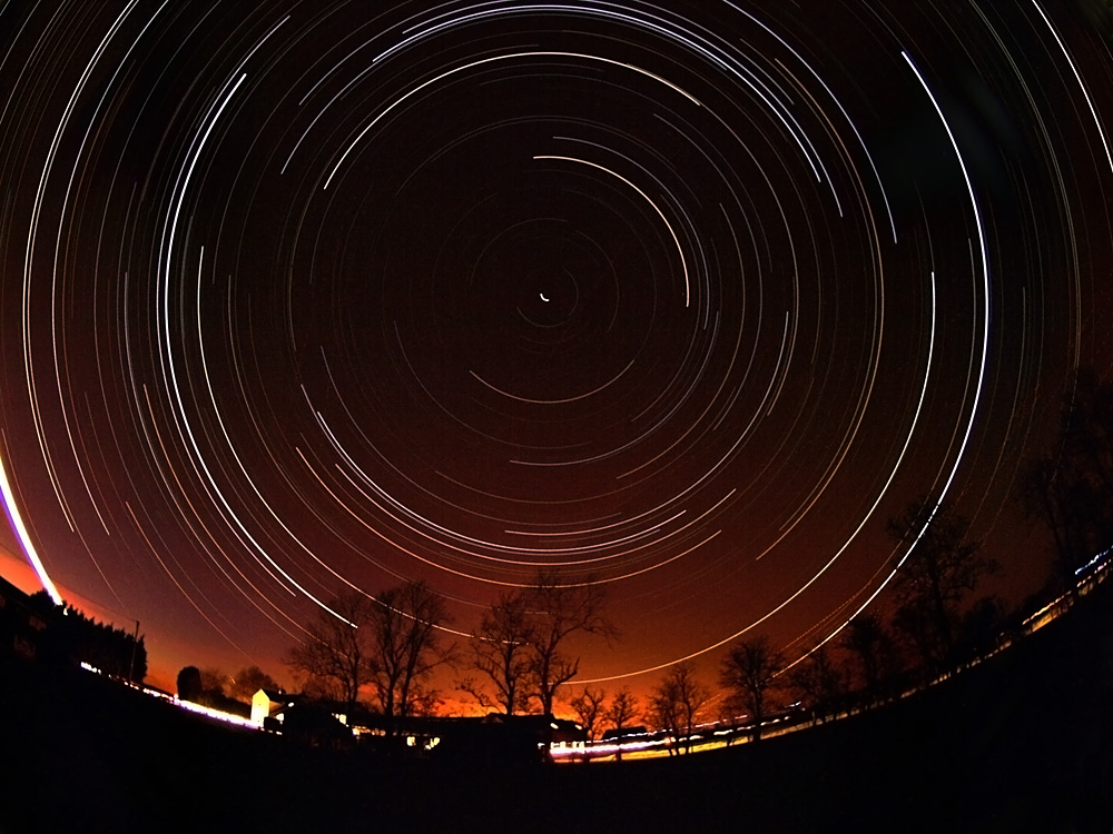Startrail captured on March 29th 2009 in my backyard, Leics. For the first time in a long time clear skies were forecast all night. I set my Olympus E3 camera with 8mm fisheye lens in an adjacent field on tripod. Rigged up the extension lead to provide continuous power and left it running all night. 15s exposures on continuous shoot. Nearly 1500 images stacked and placed on a single layer in Startrails.de software.  Probably one of the most impressive duration startrails I have attempted. 6 1/2 hours of slpendid earth rotation effected by the startrail.