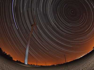 Sept 29/30 2011 startrail. This wonderful image was featured in the Leicester Mercury on Wed 5th October - http://bit.ly/nheQlM The autumnal heatwave & clear skies continues. A nice combination of a 9hr startrail set against the Gilmorton wind farm with the 0510 hrs ISS flyby just above the turbine. This is how I setup the shot. Olympus E5 with 8mm fisheye on tripod overlooking the wind farm. Camera M mode with shutter speed set at 15s and aperture wide open at F3.5. Using a remote trigger I set the camera to shoot continuous all night from 2030hrs until 0530hrs in the morning. This included for the 0510hrs ISS flyby. I woke early & retrieved camera (yawn yawn). Once back home I imported the 2000 images into Mac and stacked with StarStax software. Removed a few plane trails and the final composite is what you see :-)