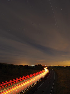 17 Oct 2013. iss flyby 2009hrs. OM-D F3.5 15s ISO 250 12mm. I shot this same composition with the E5 (see next pic). Car tails with iss over A14 East Midlands.