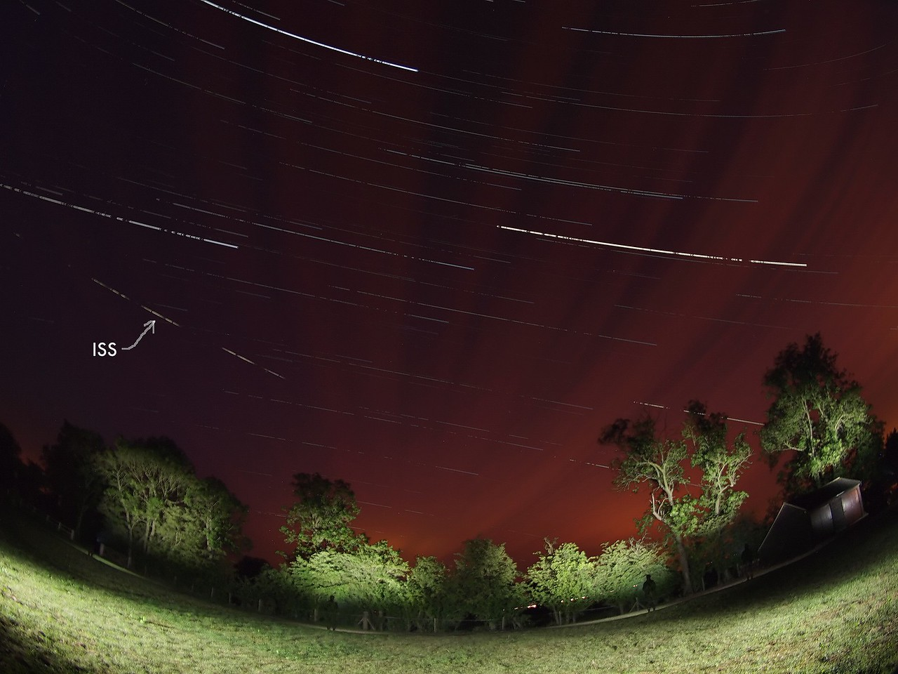 June 07 2011. First early hours ISS flyby (0208hrs) over UK skies. The ghostly scene captured from 2000 images (stacked) showing the ISS, clouds and startrail. Captured with Olympus E5 & 8mm fisheye.