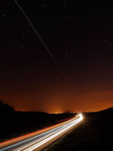 April 22 2011. Super Bright ISS passing over UK skies at 2149-54hrs. Found a great spot to watch as the ISS flew directly over and along the A14 with head/tail light streaks resulting from the long exposure. Captured with Oly E5 & 7-14mm. 12 images @15s stacked.