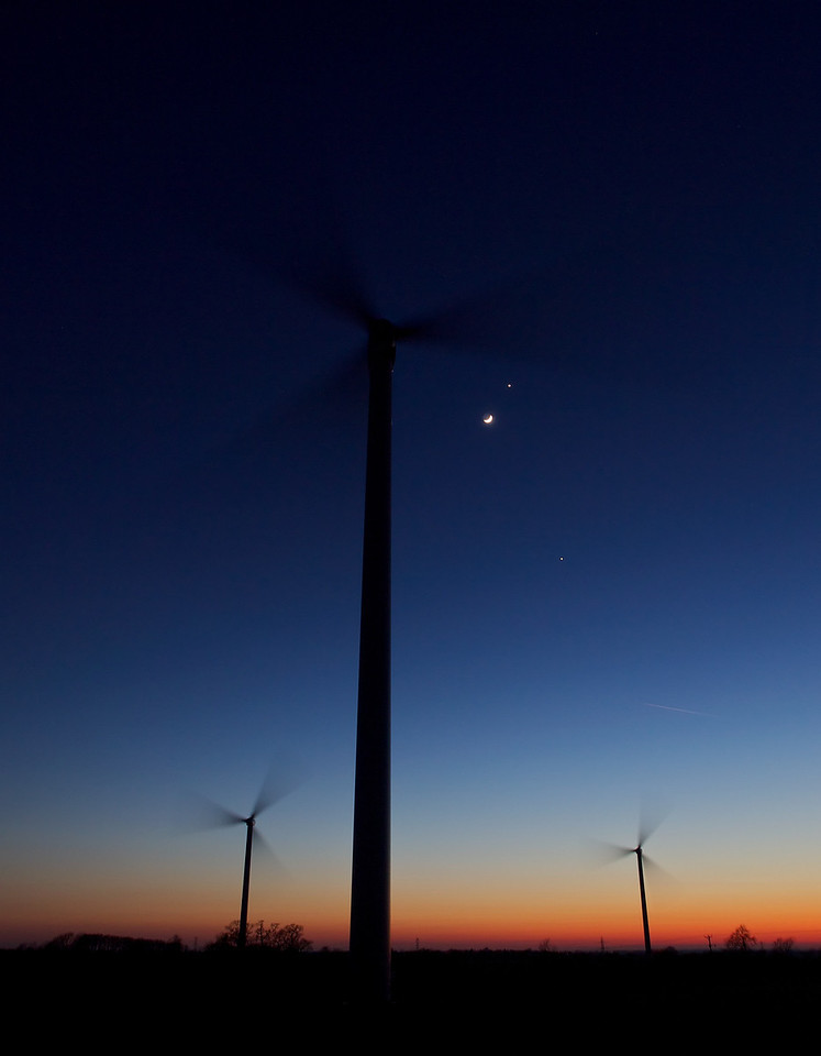March 26th 2012. Venus (top), Jupiter and Crescent moon framed against the Low Spinney wind farm at Gilmorton, Leics. A magical rare moment in time with a super conjunction event, captured within 1 hr post sunset. Olympus E5, 12-60mm SWD. F4, 0.8s, ISO 250.