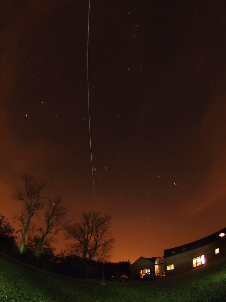 April 23 2011. ISS passing over my home (Lutterworth, Leics) 2214 - 2218 hrs. I got lazy tonight & threw the camera in the garden with a fisheye lens ;-) The ISS rose above the SW horizon passing through Gemini/Cancer (almost touching Pollux)  and near Ursa Major (Plough). Captured with Oly E5 & 8mm fisheye. 12 images @ 15s F4 stacked.
