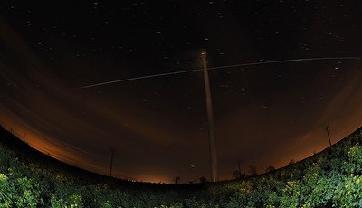 Christmas Eve ISS 24 Dec 2013. The International Space Station (ISS) flies over East Midlands (1759hrs flyby).  A very bright flyby over the Swinford wind farm, East Mids.  How did I capture this? - Camera (Olympus E-M1) with fisheye lens (Oly 8mm) set on tripod. I located the camera in a field underneath a huge turbine (Boy it was cold/windy). Setting camera in manual mode, f3.5, ISO 320 & 10s exposure time & using remote cable to shoot continuous for approx a dozen or so shots. The turbine was painted with a torch and foreground field with a few flash bursts. Once complete I imported all images & stacked in software to produce this composite image.