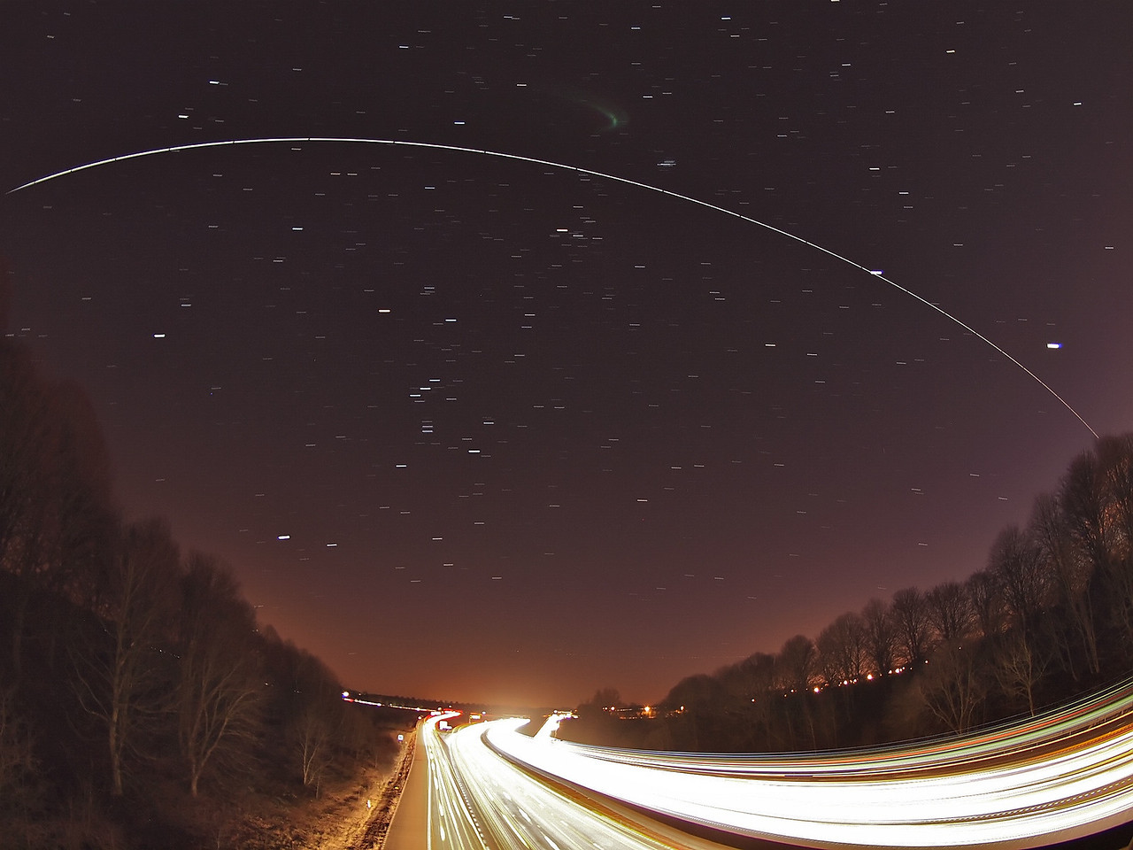 Feb 19 2012. The International Space Station (ISS) 1845hrs pass over UK skies. The super bright ISS travelling at 17,500mph flies over the more sedate 70mph motorway traffic at Lutterworth, Leics. The ISS started in the west (right) passed the first bright planet Venus (bottom right) and then almost crossed straight through Jupiter (next bright up) as it made its way east (left) and above the Orion constellation. To capture this photo I was perched on top of a motorway bridge and placed camera on tripod shooting a succession of 10s exposures. The final composite contains approx 25 images and stacked using StarStax software. Captured with Olympus E5, 8mm fisheye, F4, 10s, ISO 500.
