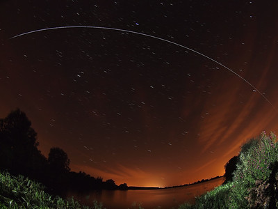 August 15th 2012. 2223 hrs flyby. Lucky clear sky window following a torrid days weather. Post frontal clear skies rule :-) This reservoir was almost empty in the Spring, now its bursting. It makes for a great foreground subject. This image shows the point at which the ISS enters Earths shadow (far left) as the trail fades. Captured with Oly E5, 8mm fish. Numerous 15s exposures, F3.5 and composite stacked with StarStax software.