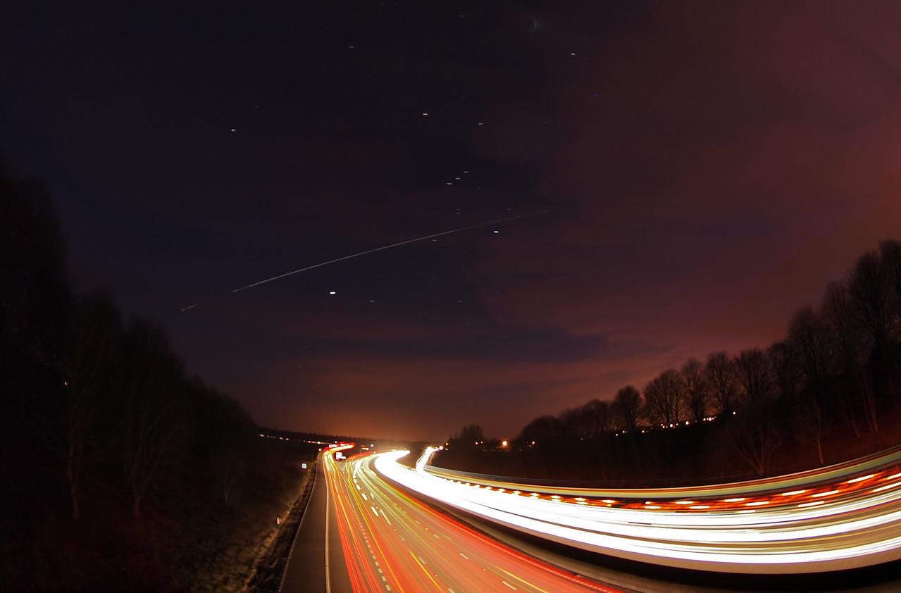March 6 2011. The ISS with space shuttle Discovery flies across the sky over Lutteroworth, bisecting the Orion constellation. I was stood on a bridge across the M1 motorway, it was an amazing sight with traffic zipping by oblivious to the technology above.  A dozen or so 10s exposures ISO 400 captured with Olympus E5 & 8mm fisheye and stacked in software.