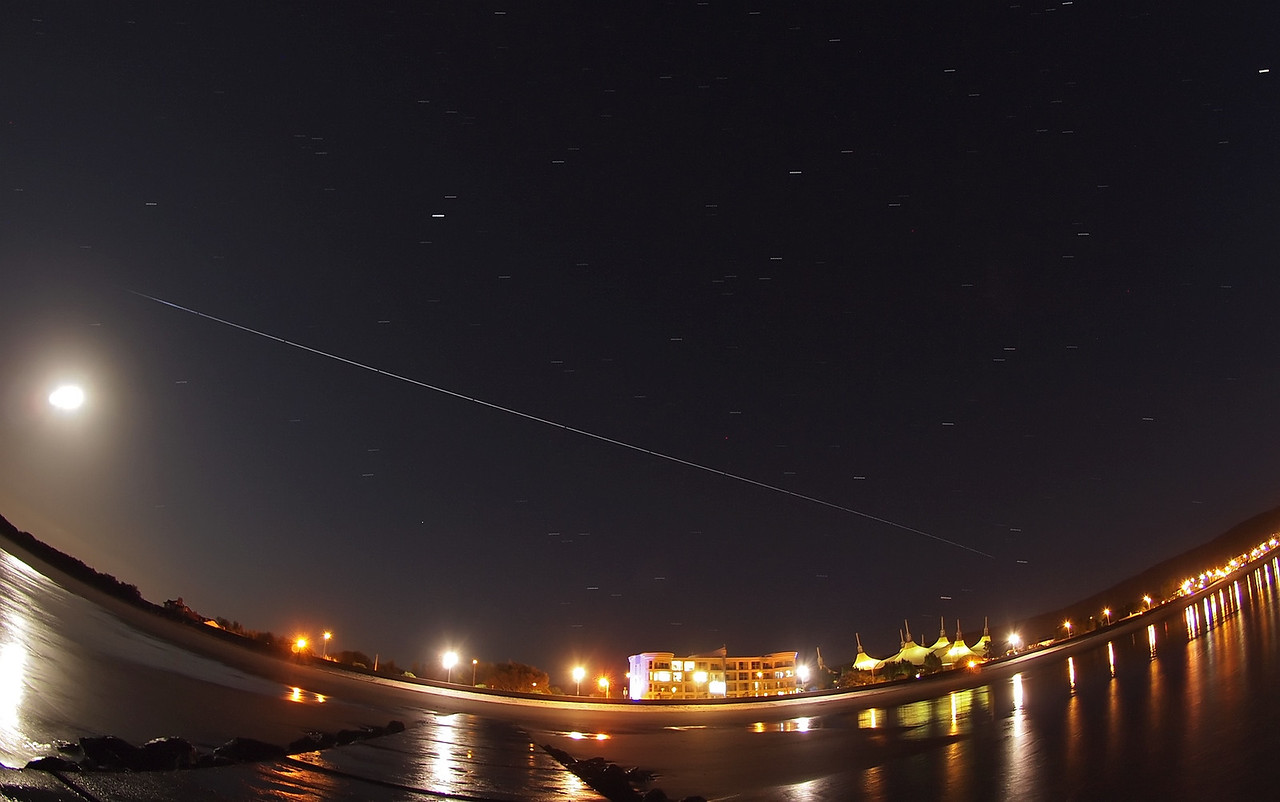 August 14 2011. ISS is back over UK evening skies. I travelled down to the north Somerset coast for the Perseid display and took the opportunity of killing 2 birds with one stone :-) Captured with Olympus E5 & 8mm fisheye. Want to know how I capture ISS shots such as this? - http://tinyurl.com/4xdnmc3 Thanks to http://www.meteorwatch.org