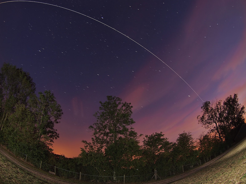 Aug 23 2011. 2126 hrs super bright pass of the ISS. Lucky to get a clear sky window with flyby directly overhead as cloud was predicted.  This one captured with Olympus E5 & 8mm fisheye. F3.5, ISO 500 and approx 9 15s exposures stacked in StarStax.