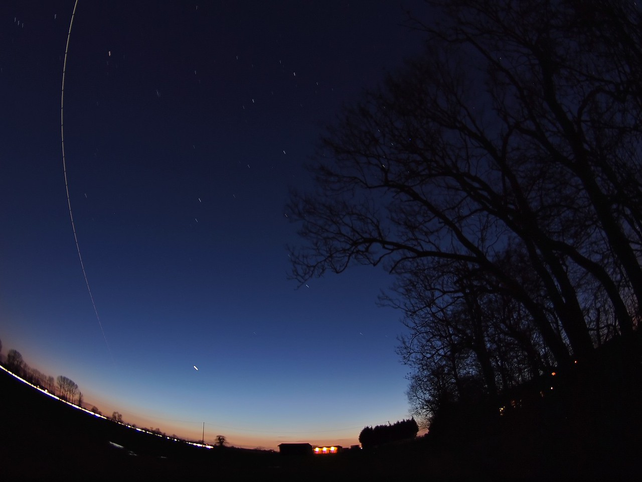 Feb 26 2011. The ISS with Space shuttle Discovery alongside fires across the UK skies.  Amazing to think Discovery has just flown over my house :-) Captured with Olympus E5 & 8mm fisheye.