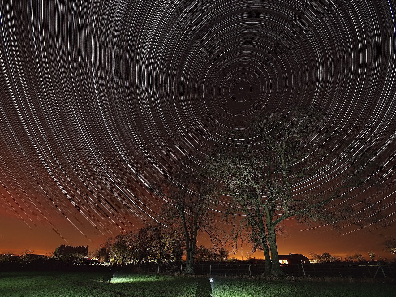 Nov 22/23 2011 startrail. Seems an age since we last had clear skies....in fact it was! Took the opportunity to grab another startrail in spot ventured before. Come out quite nice. Put camera in the field approx 1930 hrs and left it shooting continuous all night (15s exposures). Picked it up at 0730 the following morning. Captured with Olympus E5 & 8mm fisheye. 15s exposure time, F3.5 and ISO 640. Foreground and trees lit with flash bursts.