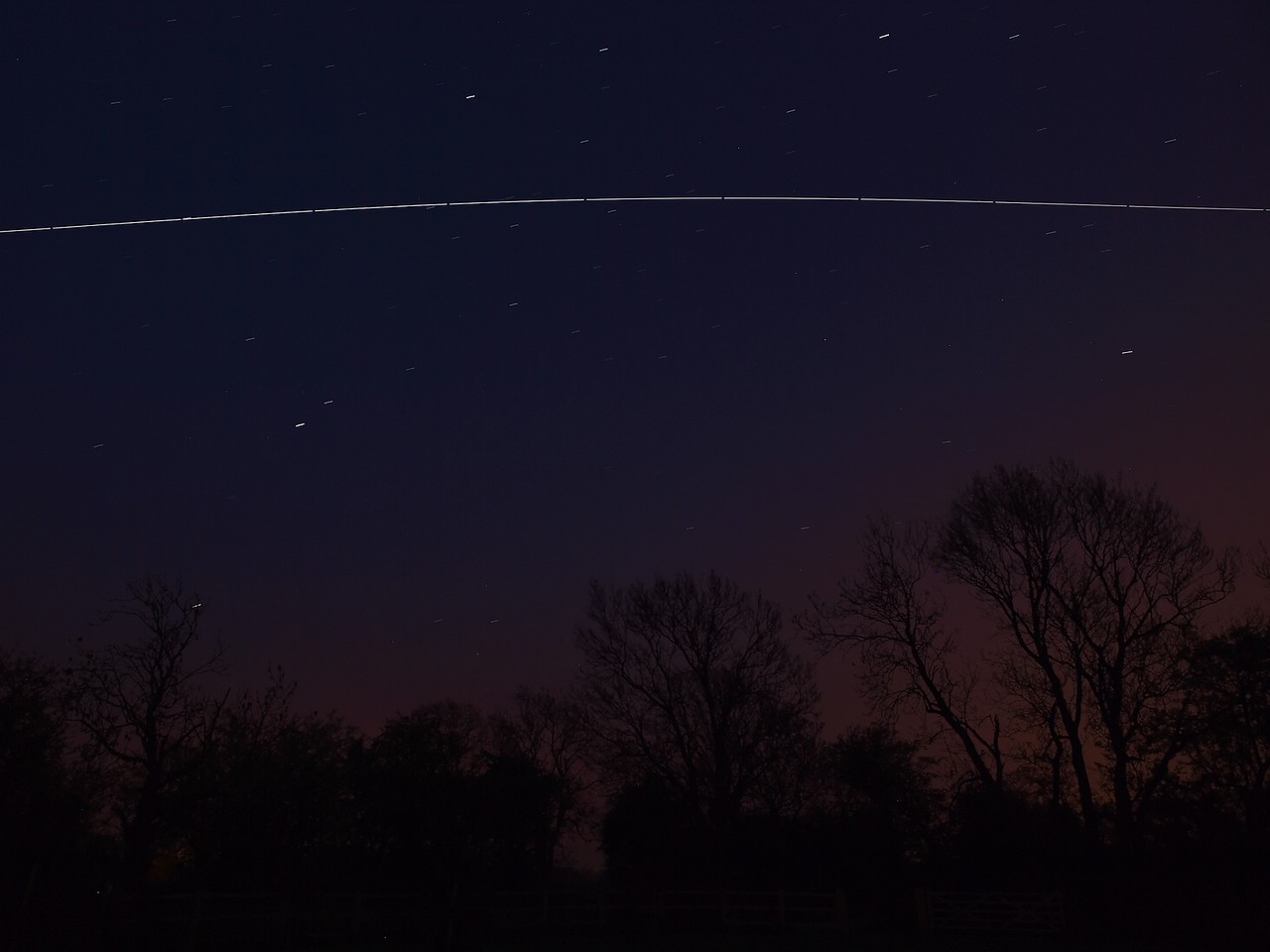 April 21 2011. International Space Station (ISS) passes over UK skies at 2125-2130 hrs. Set up 2 cameras looking south west and south east to maximise field of view, without distortion of a wide angle lens. This is the South East capture Oly E3. Both cams at ISO 400, E5 approx 12 No 6s exposures & E3 approx 12 No 10s exposures. Stacked in startrails software.
