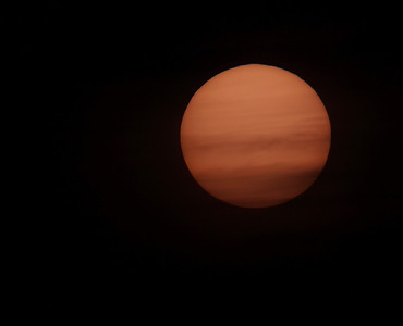 Feb 24 2011. Photo of the sun captured with Olympus E3, 90-250mm lens with x2 teleconverter (EC-20). Lens fitted with solar filter (hand made using Baader film). No visible sunspots as the sun was pretty much cloud covered. Looked nice mind :-)