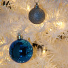 Closeup shot of our white christmas tree decorated with blue and sliver balls this year.