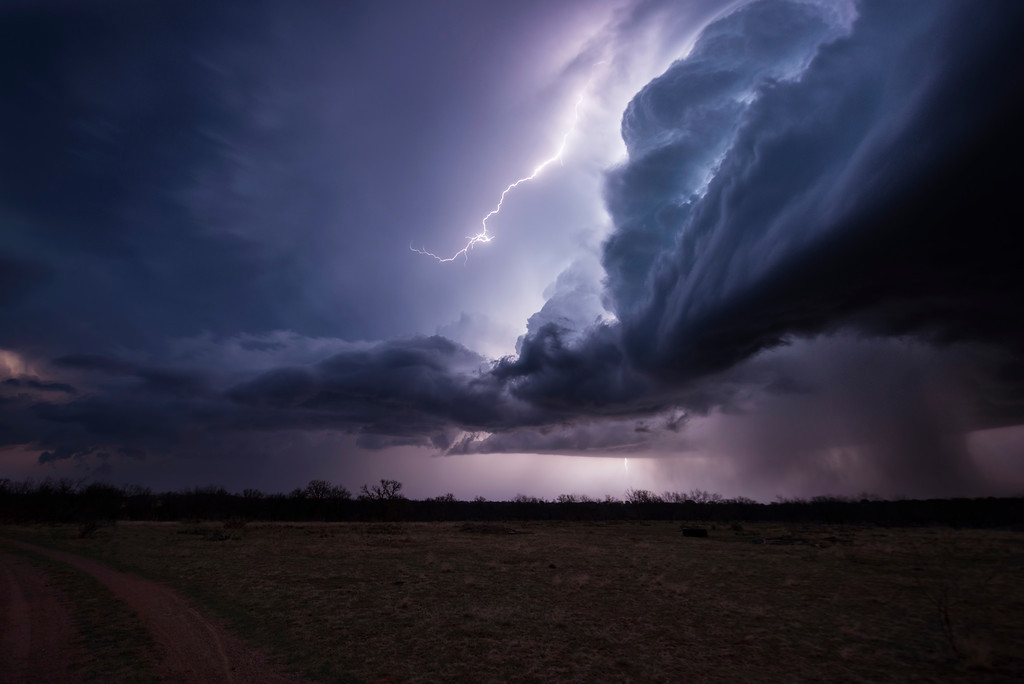 Cloud to cloud lightning crawls through the sky as a supercell thunderstorm brings large hail and strong winds to Throckmorton, Texas.