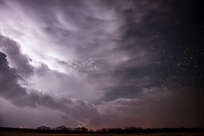 A supercell thunderstorm moves off to the east near Woodson, Texas revealing an amazing and starry Texas night sky.