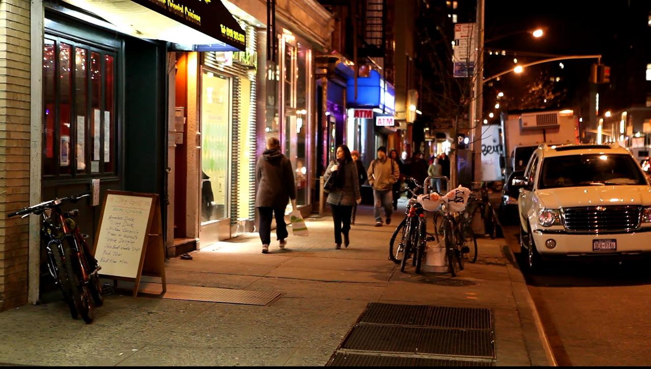 Manhattan Chelsea sidewalk at night<br /> hand held unaltered