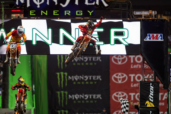 Jason Alexander celebrates his win in the 250 Main
