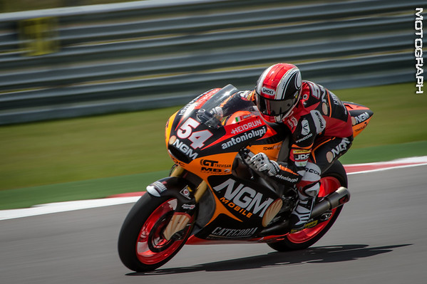 Mattia Pasini piloting the Moto2 Honda for Team NGM Mobile Racing