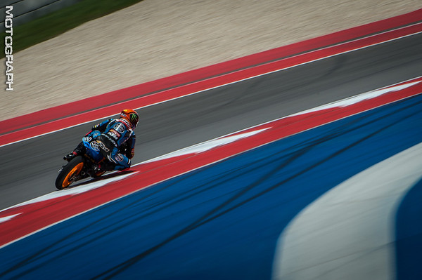 A Moto3 rider enters Turn 4