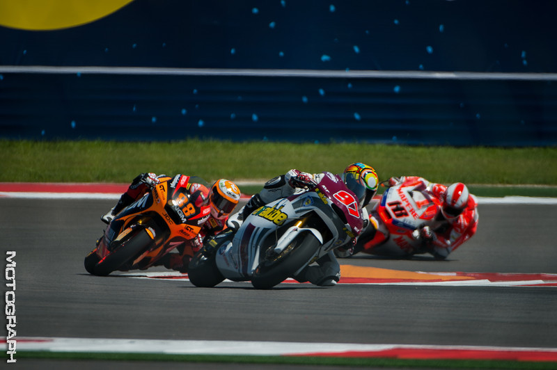 Team QMMF Racing pilot Rafid Topan Sucipto leads a scrum of Moto2 riders out of Turn 20