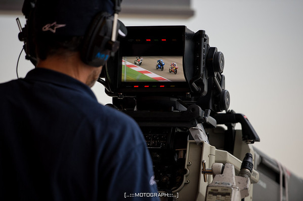 A Fox Sports cameraman captures Moto3 action on the front stretch