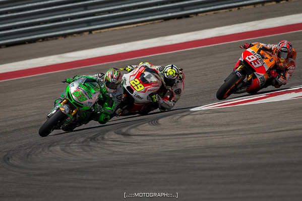 Former MotoGP champion Nicky Hayden leads a group of riders onto the front stretch in Saturday practice