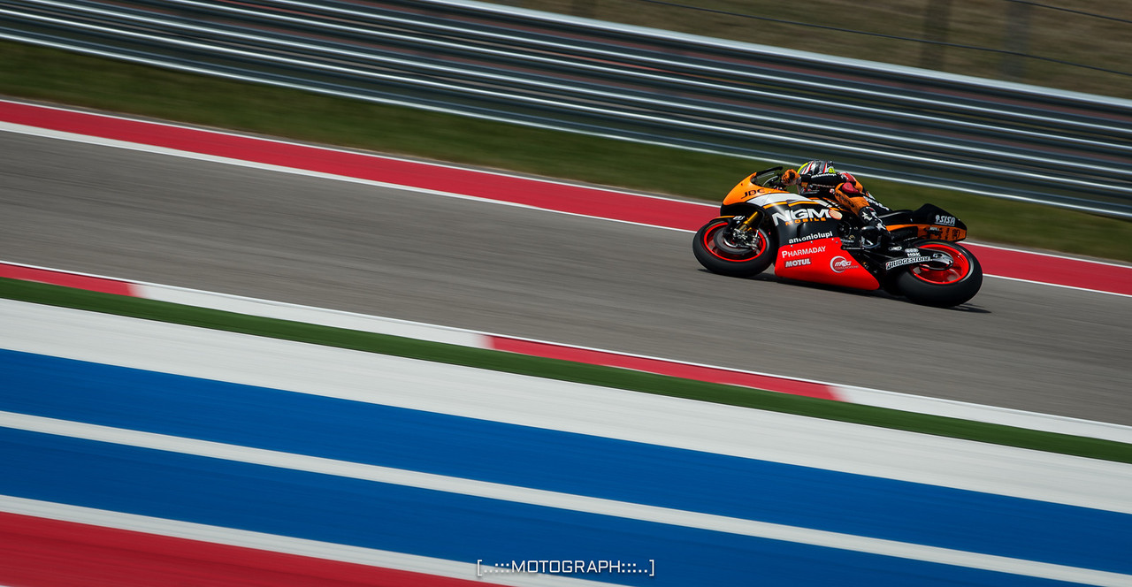 Aleix Espargaro of Team NGM Forward Racing lays it down for the crowd under the COTA tower in Turn 17