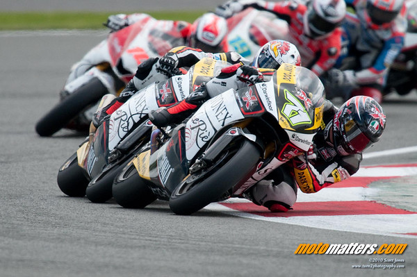 Claudio Corti leads a close group in the 2010 Silverstone Moto2 race