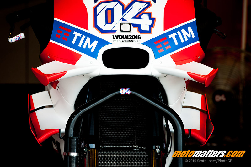 By 2016, the Ducati had sprouted wings everywhere. Here, the front view of Andrea Dovizioso's bike at Texas in 2016 shows the upper and huge lower wings