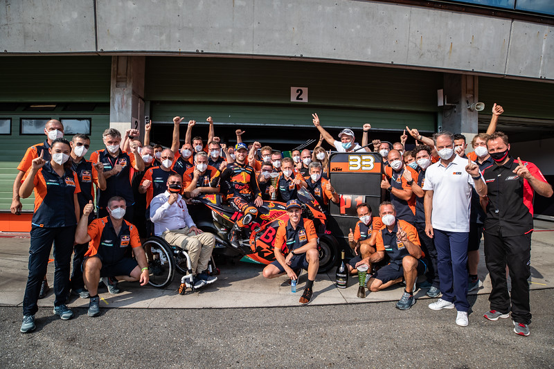 The KTM factory team celebrate Brad Binder's first win for the manufacturer in the premier class