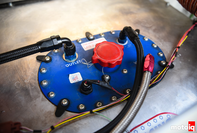 Blue ATL fuel cell top plate with hoses and wiring, red fill cap, and stainless tank