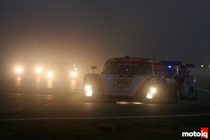Action in the pre-dawn fog during the Rolex 24 at Daytona Grand-American Rolex Series race , Daytona International Speedway, Daytona Beach, FL, January 2011.