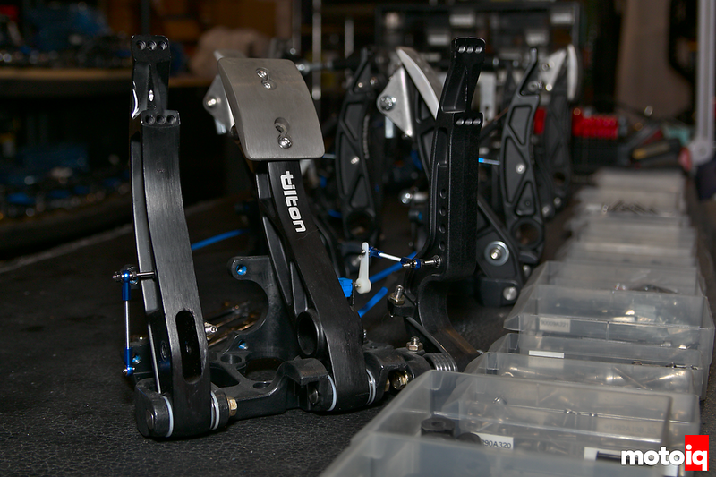 tilton pedal assemblies neatly lined up and fading into the background