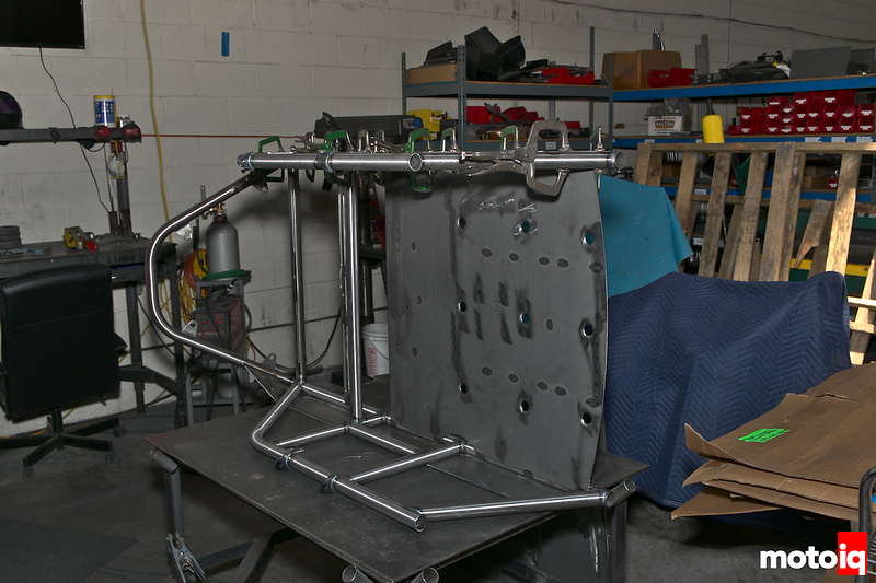 welded assembly of tubes with flat bottom welded in, laying on its side, on a welding table