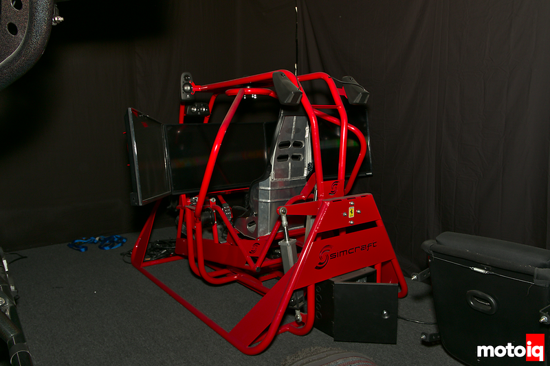 red 7/10ths scale simulator cockpit with aluminum dirt-style seat
