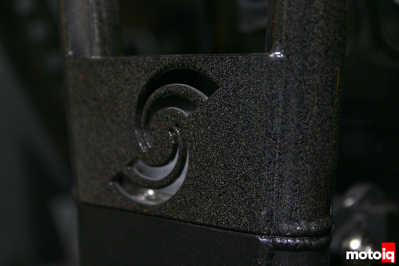close up of simcraft S machined into a sparkly coated piece of metal
