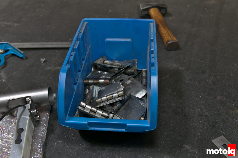 blue plastic parts holder filled with machined hinges
