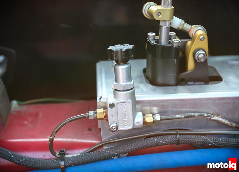 Wilwood brake proportioning valve mounted next to shifter